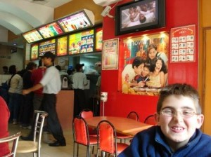 My son at a McDonald's in Delhi